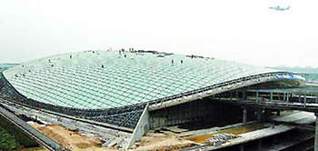 The Beijing Capital International Airport terminal roof design which will assist in the heating and cooling of the terminal.