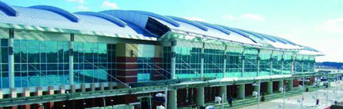 Richmond International Airport's expansion features an arched ceiling, terrazzo floors, and new elevators and escalators.