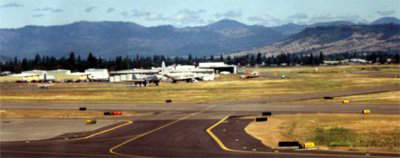 Rogue Valley International-Medford Airport prior to expansion in a quiet rural setting.