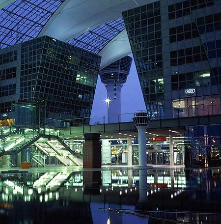 The interior of Munich Airport at night.