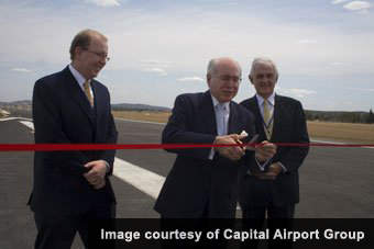 Prime Minister John Howard cuts the ribbon to formally open the new extended runway in December 2006.
