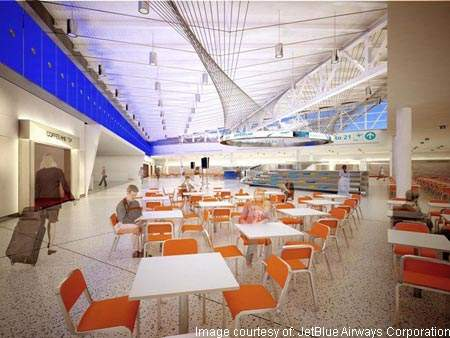 The intended 'glowing blue box' of the passenger concourse provides the 'passenger wow factor' in the new JetBlue terminal.