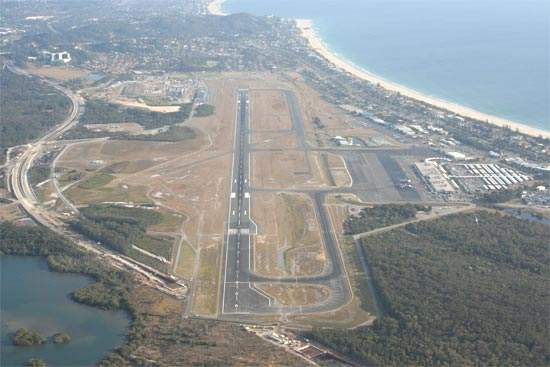Gold Coast Airport's recently extended main runway is now 2,492m x 45m and lies within a 2,552 x 150m runway strip. A full-length parallel taxiway was also added.