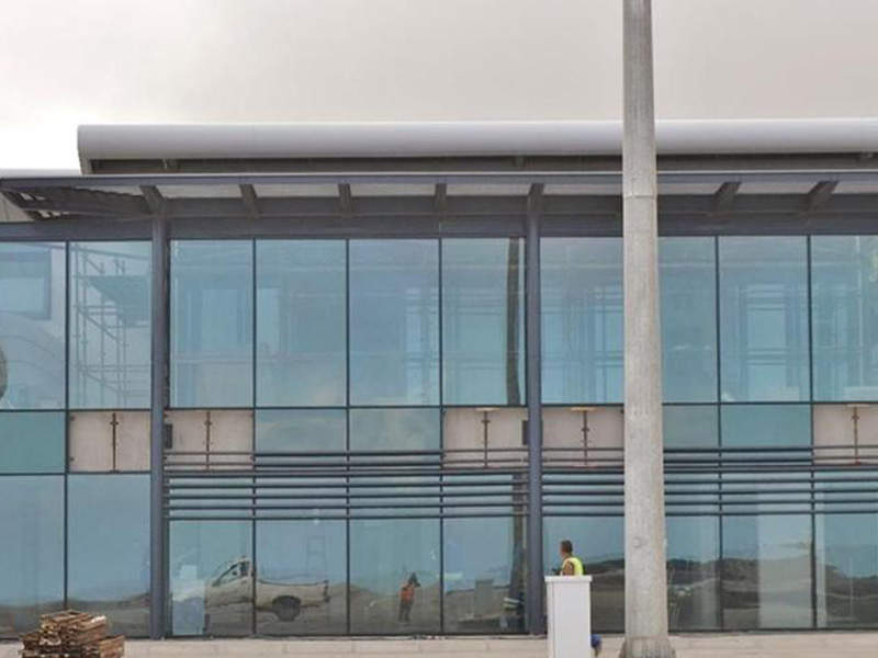 The passenger terminal building at St Helena Airport features a glass facade. Image courtesy of SHG Access Office.