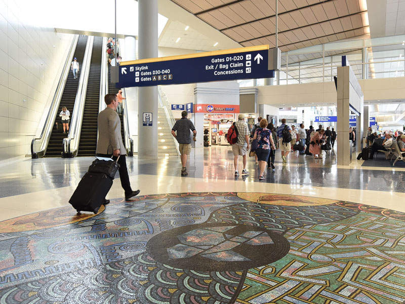 The concourse-level entrance to Skyline features new floor artworks. Image courtesy of The Dallas / Fort Worth International Airport Board U.S.A.