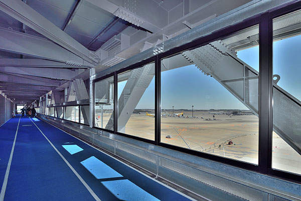 The new terminal includes an air bridge that gives the impression of walking through the air as aircraft pass underneath. Image courtesy of Narita International Airport Corporation (NAA).