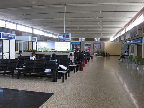 Passengers wait inside the airport.