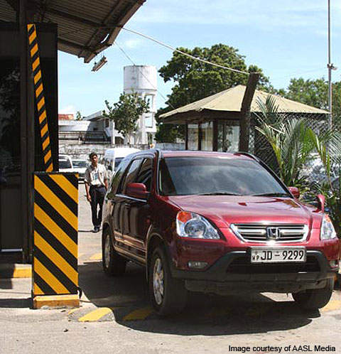 A vehicle going through the automatic entry system at the airport.