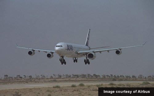 An Airbus A340 landing; Canberra's recent runway upgrade and widening was to allow large wide-bodied aircraft such as Boeing 747s, 777s and Airbus A340s to land.