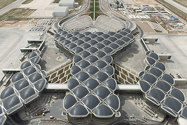 The structure of the terminal features domes protruding from columns. Image courtesy of Foster + Partners.