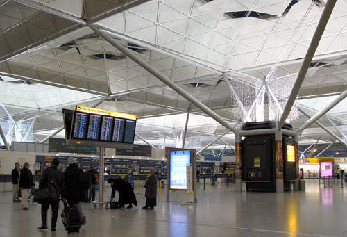 The terminal's flexible interior space divides arrivals and departures laterally.