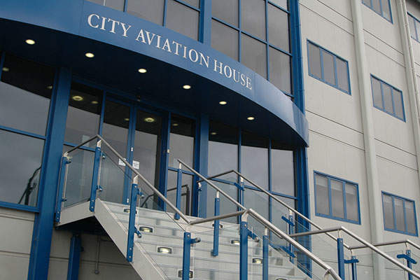 The City Aviation House beside the terminal will be replaced by a new office building. Image courtesy of London City Airport Ltd.