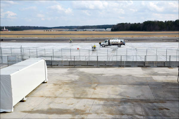 The opening date of Terminal 1 was changed from 2 March to 13 April due to inclement weather, which delayed the construction of the aircraft parking area. Image courtesy of the Raleigh-Durham Airport Authority.