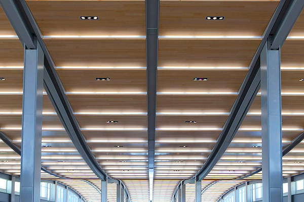Wooden ceilings of the concourse at the APM Station. Image courtesy of Jason A. Knowles © Fentress Architects.