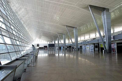 The tilted glass wall allows flights to be viewed departing and arriving.