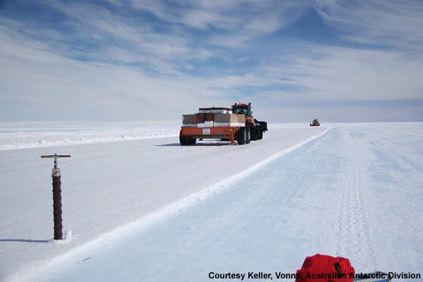 Wilkins ice runway construction during summer 2004–2005. Rolling runway with 75t roller.