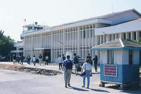 Passengers walking towards the completed terminal building at Mandalay Airport.