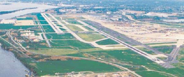 Ariel view of the airport showing the difficulties of runway expansion.