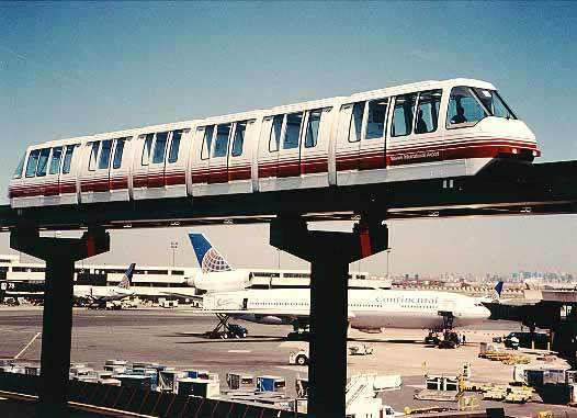 The new monorail began passenger service at Newark in 1996. A new rail link system at JFK will be op