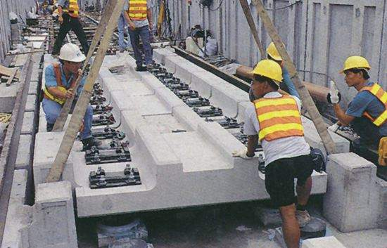 Installation of the floating slab track.