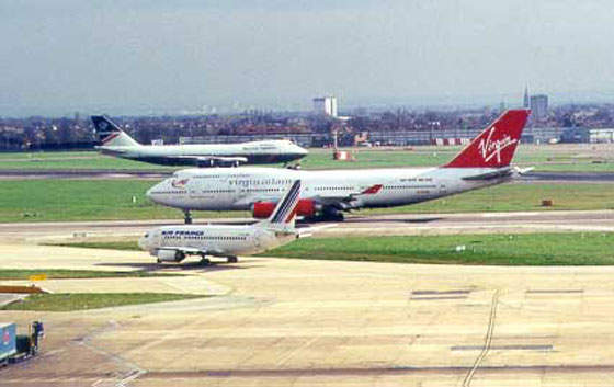 Runway at Heathrow with aeroplanes