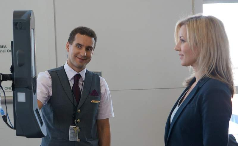 DTW_Employee Guiding Customer through Facial Recognition Boarding_0
