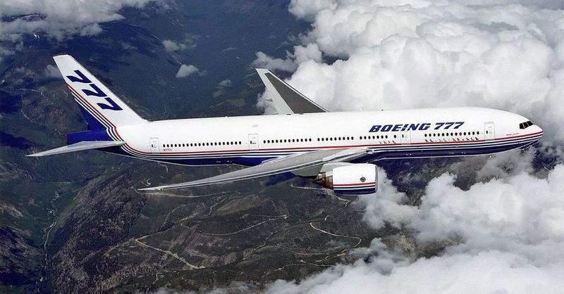 Boeing_777_above_clouds,_crop