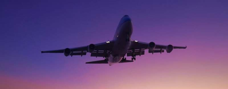 commercial aeroplane at sunset