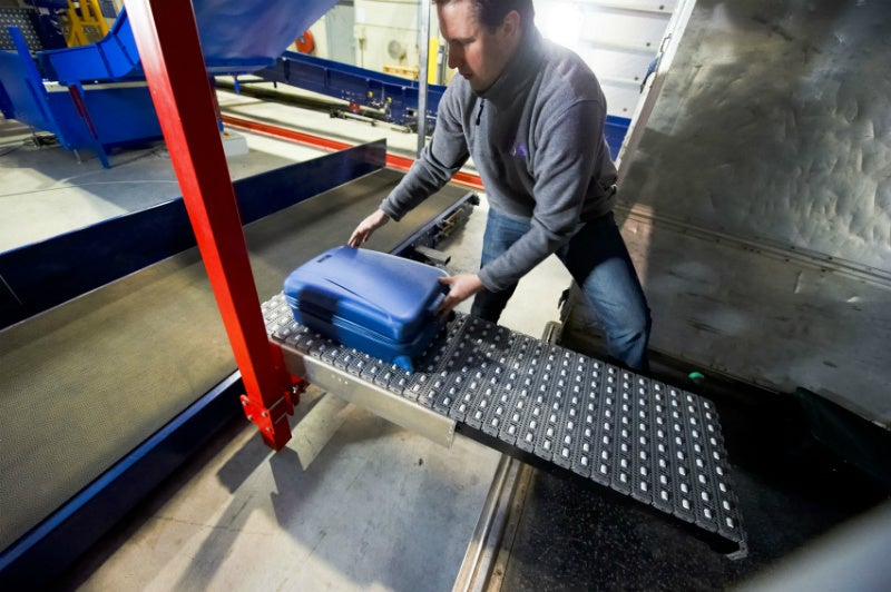 Baggage Lifting Aids and Container Handling Systems